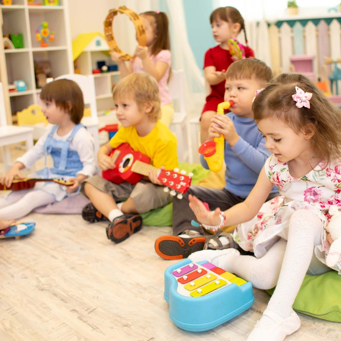 Children learning musical instruments on lesson in kindergarten or daycare