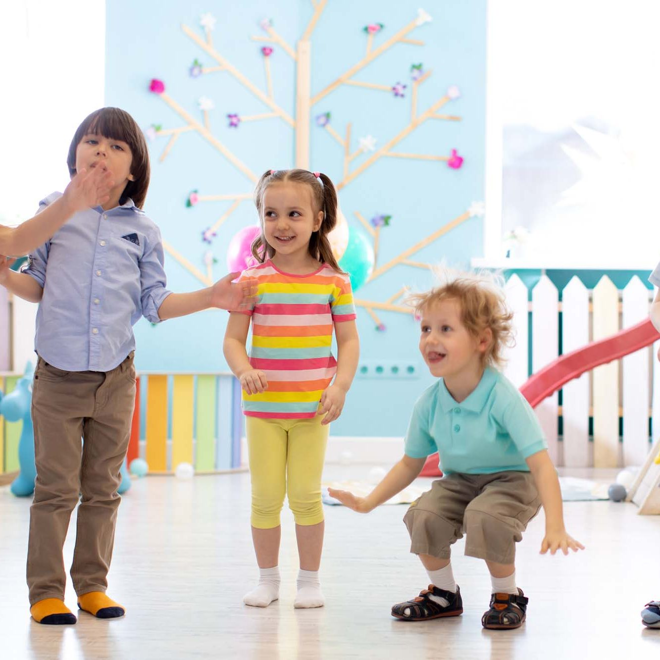 Group of happy children jumping indoor. Kids play together